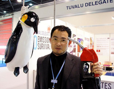 Vincent J.F. Huang, speaks to international press about the first nation to sink from global warming and warns with animal delegates of what's to come. www.modernatlantis.com.  (PRNewsFoto/Vincent J.F. Huang)