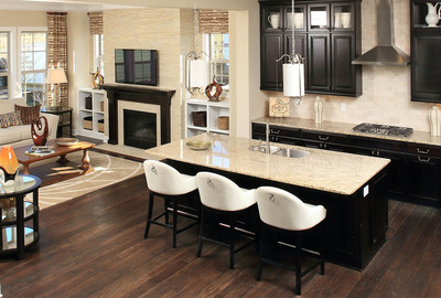 Standard Pacific Homes introduces 12 move-up home designs to Village Square at Amberly in beautiful Cary, NC. The innovative architectural concepts emphasize connectivity through open Great Rooms that flow into gourmet kitchens and the strategic use of glass which fills the homes with natural light.  (PRNewsFoto/Standard Pacific Homes)