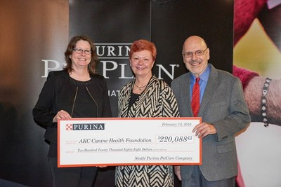Ann Viklund, Purina Director of Conformation, center, presents the 2015 PPCP donation to Dr. Diane Brown, CEO, and Dr. Duane Butherus, chair, of the AKC Canine Health Foundation.
