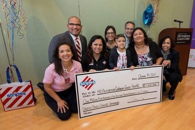 Stripes Stores Vice President of Marketing Eduardo Pereda presents a check for $1,405,706 to Eugenie S. Kleinerman, M.D., Head of MD Anderson Children's Cancer Hospital. Customers and employees of Stripes Convenience Stores raised more than $1 million for pediatric cancer research and education programs, surpassing the company's initial goal of $500,000, during the Stripes Stores Celebrates Tomorrows campaign from September 1 to 28, 2014.