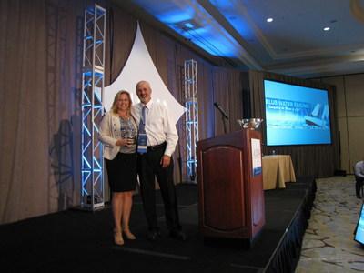 LIDMA President Byron Udell presents Cynthia Farrow with Vision Award
