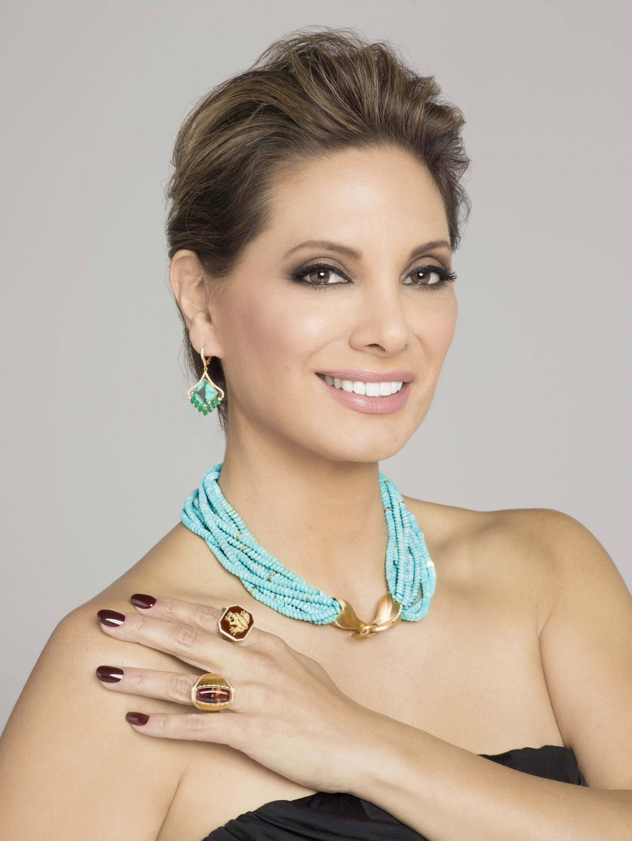 2016 AGTA Spectrum Awards(TM) jewelry worn by Alex Meneses. Earrings by Bella Campbell, necklace by Naomi Sarna, rings by Kim Hurlbert-Sarosi and Ricardo Basta.