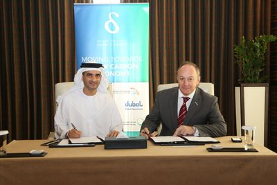 DCCE Chairman Waleed Salman and CH2M HILL's Neil Reynolds sign MoU to support Dubai Carbon Ambassador Program