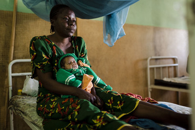 Sophie*, 38, and her newborn baby delivered through cesarian operation in Bouar hospital, Central African Republic (* name changed to protect identity). Infant and maternal mortality rates in the CAR are some of the worst in the world. Photo by Greg Funnell for Save the Children.