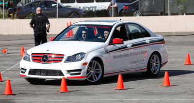 Student participates in Mercedes-Benz distracted driving demonstration.  (PRNewsFoto/Mercedes-Benz USA)
