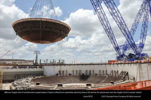 The 900-ton Vogtle Unit 3 containment vessel bottom head is lifted from the assembly stand by a heavy lift derrick for placement into the Vogtle Unit 3 nuclear island. (PRNewsFoto/Georgia Power)
