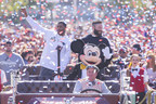 (February 2, 2015) New England Patriots players Julian Edelman (right) and Malcolm Butler were joined by Mickey Mouse as they celebrated their team's Super Bowl XLIX championship victory with a special cavalcade down Main Street, U.S.A. at Disneyland park in Anaheim, Calif., on Monday. In the frenzied moments following their team's feat of capturing the National Football League championship on Sunday, Edelman and Butler stood in front of a TV camera and shouted four words that have become an iconic reaction to milestone achievement: 'We're going to Disneyland!'(Paul Hiffmeyer/Disneyland)