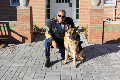 "Sergeant Major Jesse Acosta And Guide Dog ""Charlie Boy"".  (PRNewsFoto/Southern California Gas Co.)"
