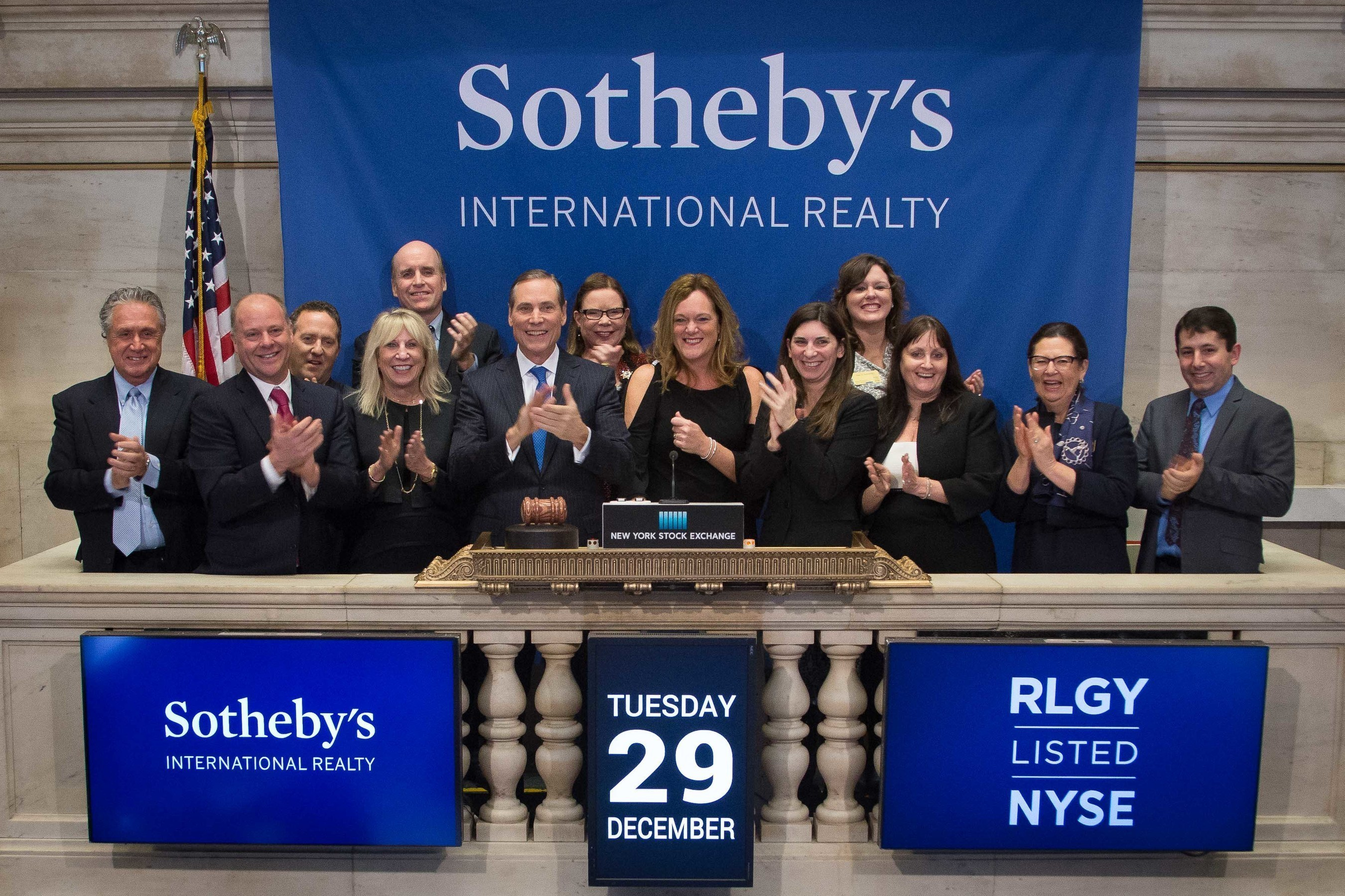 Representatives from Sotheby's International Realty Affiliates LLC, a subsidiary of Realogy Holdings Corp. (RLGY), visit the NYSE to mark the company's 40th Anniversary.  Chief Executive Officer Philip White, joined by Wendy Purvey, chief marketing officer, ring The Closing Bell(R). Photo Credit: NYSE/Valerie Caviness