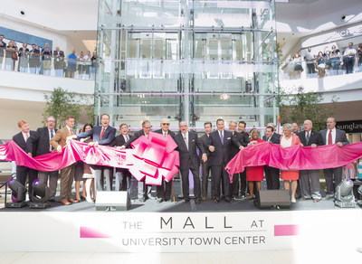 A. Alfred, Robert and William Taubman, along with Randy Benderson and other dignitaries, cut the ribbon today to open The Mall at University Town Center in Sarasota, Fla. The mall opened with more than 100 retailers and restaurants, half of which are unique to the market.  Developed through a partnership between Taubman and Benderson Development, it is the only newly built enclosed regional shopping center to open in the U.S. this year.