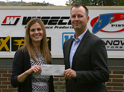 Performance Motorsports International CFO, Michael Dudiak, presents Keri Haibach of Make-A-Wish Foundation of Ohio, Kentucky, and Indiana with a $10,000 donation.