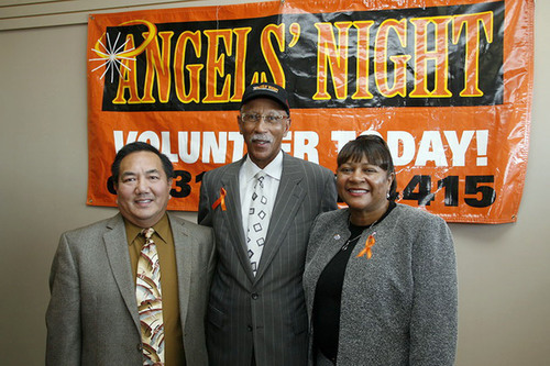 White Castle System, Inc. Assistant Regional Director, John Chin, (left) and Cheryl Collier (right), Detroit District Supervisor join Detroit Mayor Dave Bing (middle), during the annual Angel's Night kick off.  White Castle is Angel's Night original sponsor. For the 14th year White Castle will provide over 10,000 free hamburgers, fries and beverages to Angel's Night volunteers from October 29th - October 31st.  (PRNewsFoto/White Castle System, Inc.)
