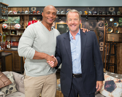 "Eddie George with host Robert ""Daddy"" Nickell (PRNewsFoto/Daddy and Company)"