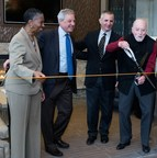 Cutting a ribbon to officially open Harrison at Reston Town Center were (left to right): Fairfax County (VA) Supervisor Cathy Hudgins (D-Hunter Mill); Albert H. Small, Jr. and Douglas Erdman of Renaissance Centro; and Robert E. Simon, Jr., founder of Reston.