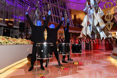 Blue Man Group performs in The Conservatory at MGM National Harbor as two dozen Miss World contestants look on, at the resort's grand opening party.