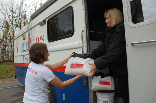 AmeriCares relief workers load supplies onto the aid organization's mobile clinic on Monday, Oct. 29, 2012,  ...