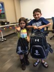 Children of injured veterans were given supply-filled backpacks as part of a recent Wounded Warrior Project back-to-school open house.