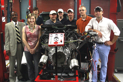 Students from Tennessee Technical Center-Nashville and Nashville State Community College are shown with the QX56 engine they removed and made operational outside the vehicle.  (PRNewsFoto/Infiniti)