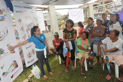 Families receive training on the proper use of materials included in shelter repair kits provided by Habitat ...