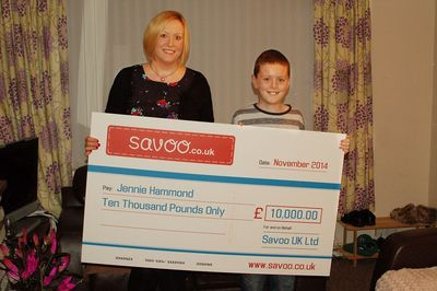 Jennie, her son Ryan and the cheque for £10,000 from Savoo
