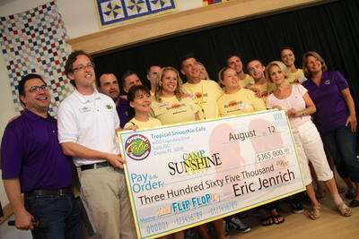From left, Tropical Smoothie Cafe Chief Operating Officer Mike Rotondo, Camp Sunshine Executive Director Matt Hoidal, Tropical Smoothie Cafe Regional Director Bob Fischer, host of Tropical Smoothie employees and franchisees volunteering this week at Camp Sunshine, Camp Sunshine Founder Anna Gould, and Tropical Smoothie Cafe Regional Director Dana Lockyear.  (PRNewsFoto/Tropical Smoothie Cafe)