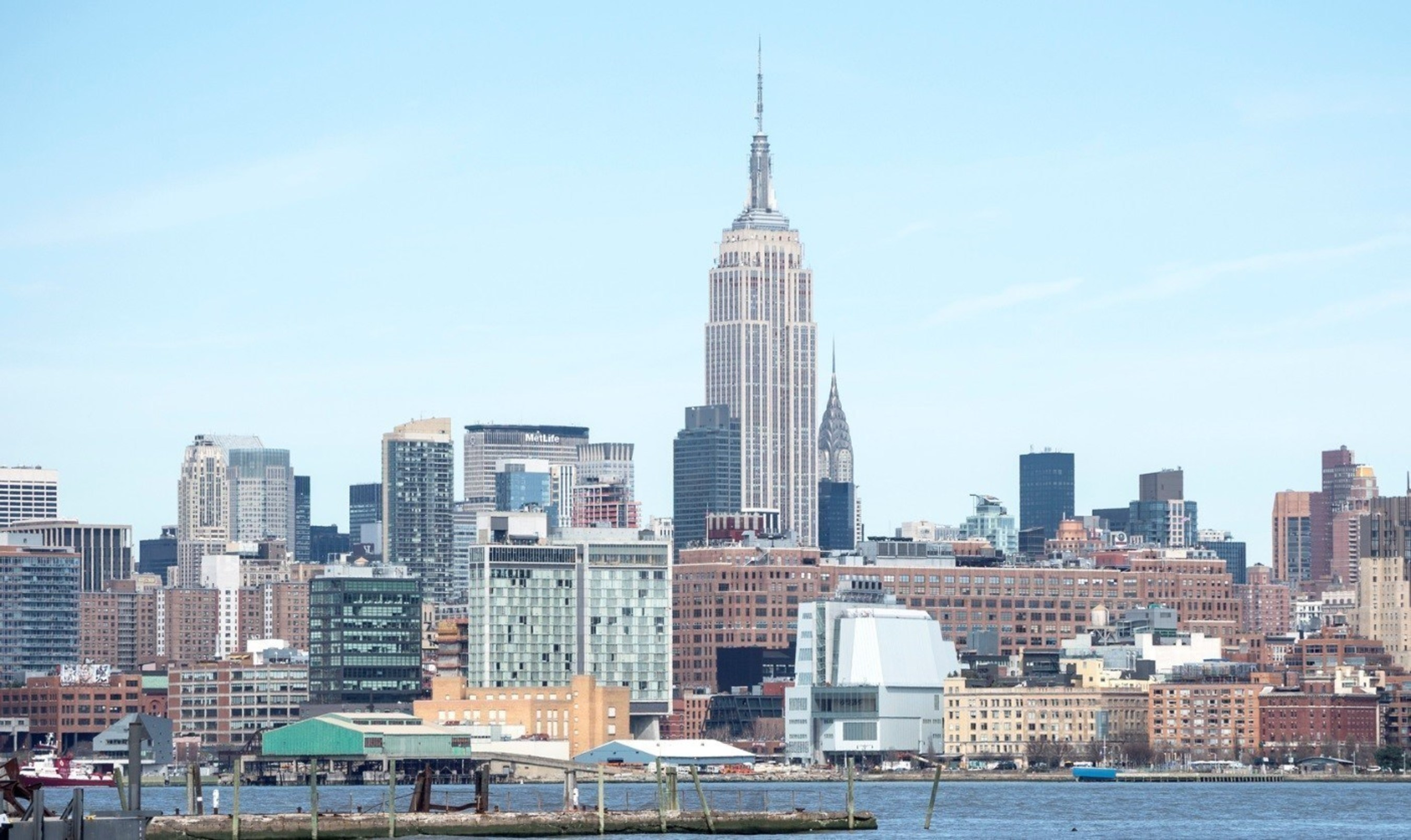 Photo of the new Whitney Museum of American Art (white building in center foreground) and the Empire State Building by Timothy Schenck