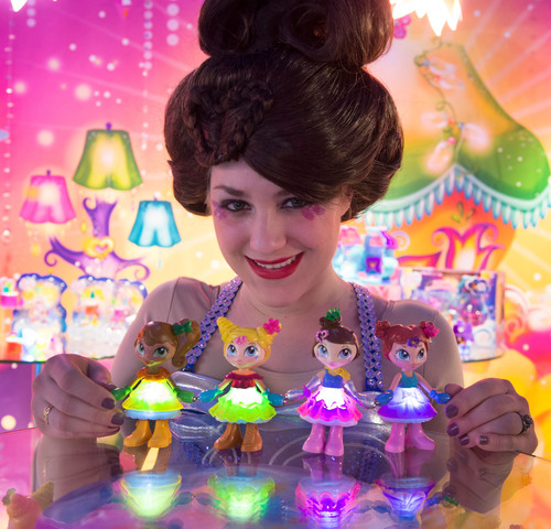 Lum Lums' Valerina holds hands with her friends at Toy Fair 2014 in a circle of friendship. She and her ...