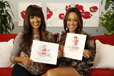 Tamera Mowry-Housley and Tia Mowry-Hardrict show off their Playtex Baby Beginnings Imagined illustrations done by illustrator Julie Olson