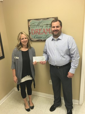 Liberty National Agency Owner Jason Neal and Dawn Owens of The Link of Cullman County