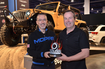 Mark Allen, Head of Jeep Design and Pietro Gorlier, President and CEO for MOPAR with their 2012 SEMA Award for the Jeep Wrangler named Hottest 4x4-SUV.  (PRNewsFoto/The SEMA Show)