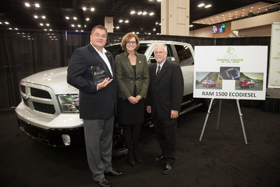 San Antonio Auto Dealers Association President Pam Crail and Green Car Journal Editor Ron Cogan present the 2015 Green Truck Award to Director, RAM Brand at Chrysler Robert Hegbloom for the RAM 1500 EcoDiesel