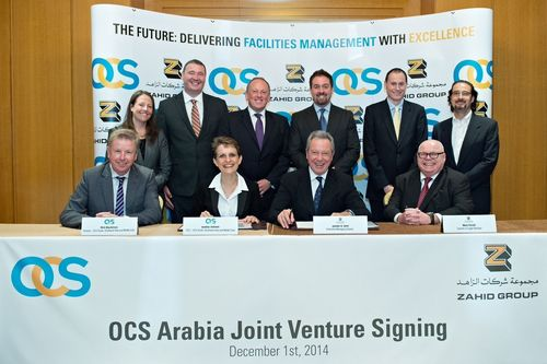 Executives of OCS Group and Zahid Group at the signing in Dubai to create the OCS Arabia facilities services joint venture in Saudi Arabia. The new OCS Arabia venture will be headquartered in the King Abdullah Economic City and will complement OCSâeuro(TM)s existing operations in the Middle East. (PRNewsFoto/OCS Group Ltd and Zahid Group)