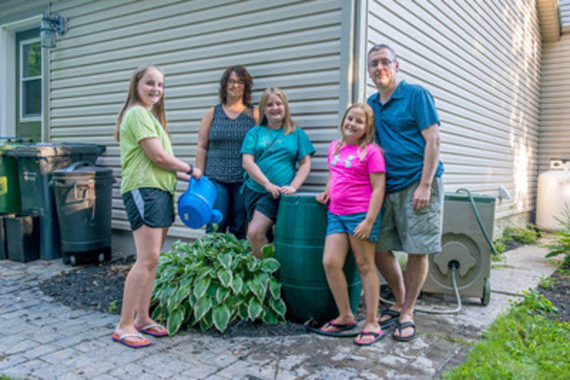The Callaghan family with their rain barrel (CNW Group/Insurance Bureau of Canada)