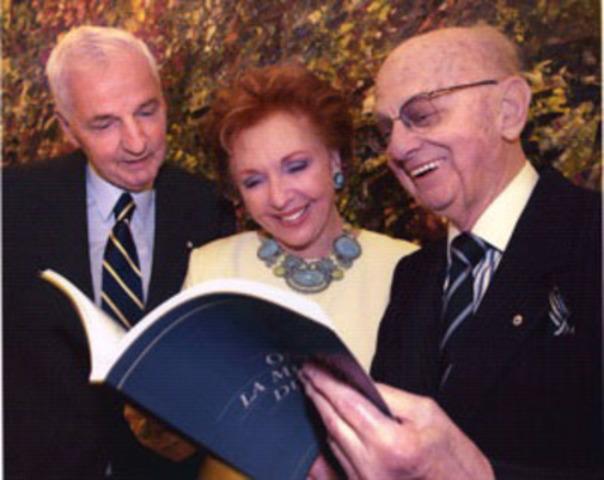 """Mr. and Mrs. Desmarais with Pierre Béique taken on the occasion of the launch of his book, """"Ils ont été la musique du siècle"""", in 2001. (CNW Group/ORCHESTRE SYMPHONIQUE DE MONTREAL)"""