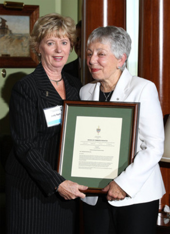 York West MP Judy Sgro (L) presents a copy of her remarks, which she made in the House of Commons in recognition of Dr. Anne Golden (R), President and CEO of The Conference Board of Canada. Dr. Golden is retiring after 11 years as head of The Conference Board of Canada. (CNW Group/CONFERENCE BOARD OF CANADA)