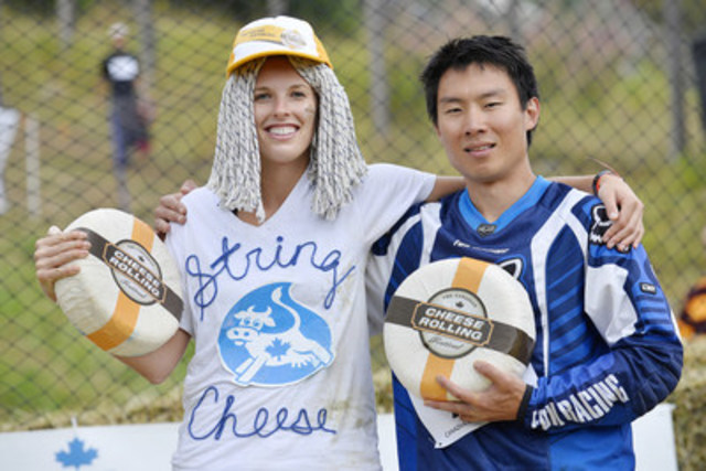 Rebecca Sharar from Bainbridge, Washington and Paul Nguyen from Whistler, British Columbia were crowned champions at the 2015 Canadian Cheese Rolling Festival and took home an unusual trophy: an 11-lbs wheel of Canadian Boerenkaas cheese! (CNW Group/Dairy Farmers of Canada (DFC))