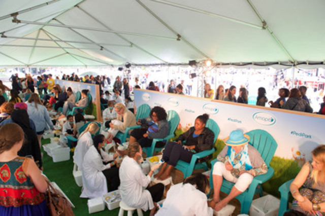 Torontonians enjoying free pedicures to set GUINNESS WORLD RECORDS Title for Most Pedicures Given in 8 Hours at Amopé Pedi Park. (CNW Group/CNW Enriched News Releases)