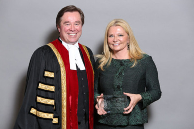 Law Society Treasurer Thomas G. Conway congratulates Toronto paralegal Paula Stamp on receiving the Law Society's 2014 Distinguished Paralegal Award at its annual award ceremony on May 21. (CNW Group/The Law Society of Upper Canada)