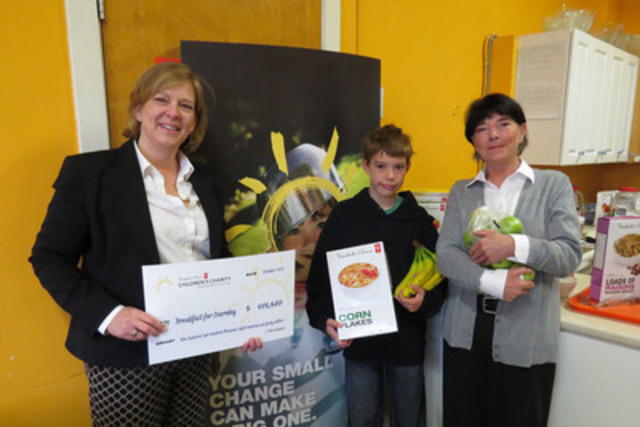 Left to right: Peggy Hornell, executive director, President's Choice® Children's Charity, St. Catherine's School student Emmitt Penniston and Breakfast for Learning's Atlantic region coordinator, Beverley Mahon. Today PCCC announced a gift of $919,840 to Breakfast for Learning to support school nutrition programs across Atlantic Canada. (CNW Group/President's Choice Children's Charity)