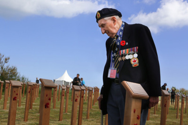 Canadian Veteran Joseph Cauch stands among newly mounted markers commemorating Canada's fallen at Juno Beach Centre, France. Veterans Affairs Minister, Julian Fantino, spoke today at the special ceremony leading up to tomorrow's 70th anniversary of D-Day. (CNW Group/Veterans Affairs Canada)