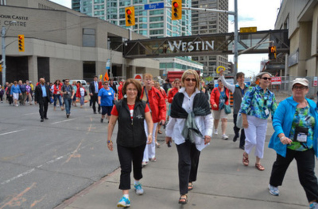 CFNU President Linda Silas (left) leads hundreds of nurses from across Canada as they embark on a walk to a rally in support of Mental Health Care. (courtesy of Ontario Nurses' Association/John Maclennan) (CNW Group/Ontario Nurses' Association)