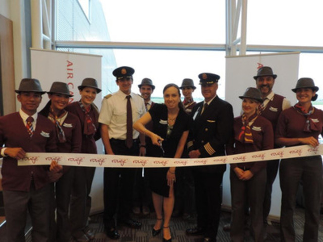 Air Canada rouge Montreal Barcelona 1 - Rosemary Capparelli (center - Senior Director of Finance for Air Canada rouge), Stephane Picard (second from right - Air Canada rouge Regional Manager Montreal, In Flight Service), rouge crew and pilots cut the ribbon to mark the launch of the first flight from Montreal to Barcelona on 4 June 2014 (CNW Group/Air Canada rouge)