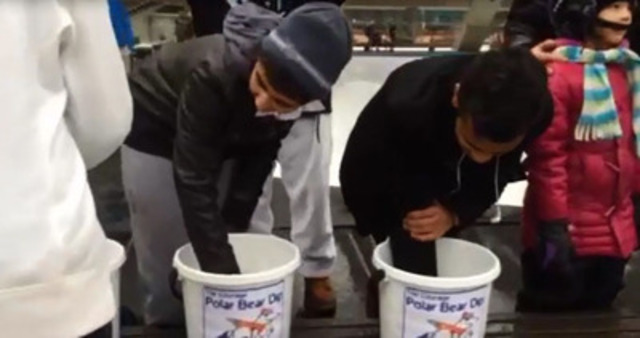 Video: Brave participants dare to dip their hands in a bucket of freezing water