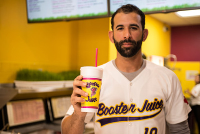 José Bautista, right-fielder for the Toronto Blue Jays, blends a smoothie at the grand re-opening of the Booster Juice store located at 2420 Bloor Street West, Toronto, which he assumed ownership of today after three years as the company's spokesperson. Sales from the June 30 celebrations will benefit the Bautista Family Education Fund. (CNW Group/Booster Juice)