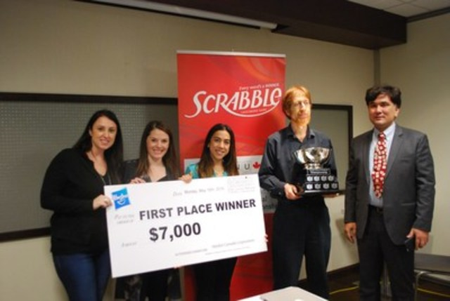 Ottawa resident Adam Logan defends his title and is crowned the 2016 Canadian National Scrabble champion for the fifth time. (CNW Group/Hasbro Canada)
