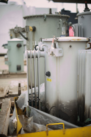 At one of Toronto Hydro's 'transformer graveyards' (this one at 500 Commissioners Street), a transformer waits for the next chapter of its life to begin. It is one of many transformers that have failed or been retired from the system. Parts are recycled, potentially reincarnated as future transformers. (CNW Group/Toronto Hydro Corporation)