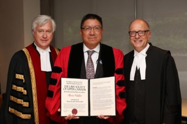 Grand Chief Alvin Fiddler of Nishnawbe Aski Nation (centre), received an Honorary Doctor of Laws degree (LLD) on September 23 at the Call to the Bar ceremony in Toronto. Here, he is congratulated by Law Society Treasurer Paul Schabas (left) and Law Society CEO Robert Lapper. Grand Chief Fiddler received the LLD in recognition of his leadership and championing the cause for truth and social justice for First Nation communities. (CNW Group/The Law Society of Upper Canada)
