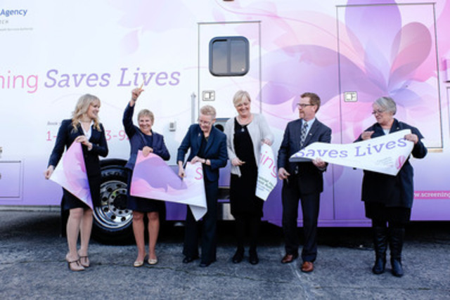 Health Minister Terry Lake helps to cut the ribbon for B.C.'s first digital mammography vehicle.  This new mobile coach is the first of three that will soon begin travelling the province to provide cancer screening services to women in rural and remote communities.  Pictured from left to right are: Lise Kuramoto, Shoppers Drug Mart VP Operations; Wendy Slavin, CEO Canadian Breast Cancer Foundation - BC Yukon Region; Dr. Christine Wilson, Medical Director, Screening Mammography Program, BC Cancer Agency; cancer survivor Christine Bowles; BC Health Minister Terry Lake; and Fraser-Nicola MLA Jackie Tegart. (CNW Group/Shoppers Drug Mart Corporation)