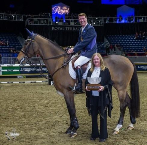Susan Grange both presented and accepted the All-Canadian Cup, awarded for the Leading Canadian-owned horse. Sponsored by Grange's Lothlorien Farm, Dixson was this year's winner, piloted by Ian Millar. Photo by Ben Radvanyi Photography (CNW Group/Royal Agricultural Winter Fair)
