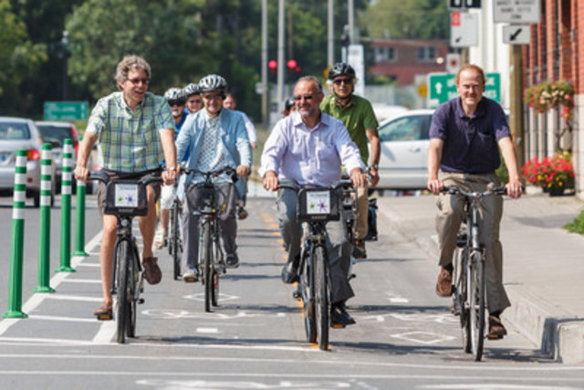 From left to right: Russell Copeman, Mayor of the Côte-des-Neiges—Notre-Dame-de-Grâce (CDN—NDG) borough, Daniel Lambert, spokesperson for the NDG Cyclists & Pedestrian Association, Aref Salem, councillor for the district of Norman-McLaren and member of the Ville de Montréal executive committee responsible for transportation, Jean-François Pronovost, vice-president for Development and Public Relations at Vélo Québec, and Peter McQueen, councillor for the district of Notre-Dame-de-Grâce. (CNW Group/Ville de Montréal - Arrondissement de Côte-des-Neiges - Notre-Dame-de-Grâce)